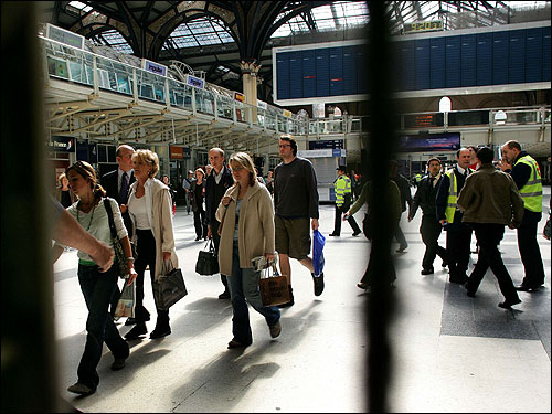 Commuters evacuated from the Liverpool Street station after a suspect package was discovered nearby just 24 hours after four bombs brought London's public transport system to a halt.