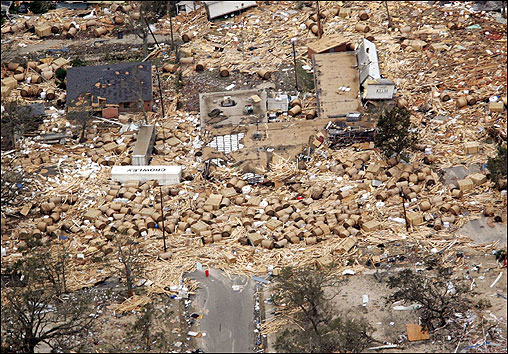 A lumber and paper building was destroyed and scattered in Pascagoula, Miss., after Hurricane Katrina hit.