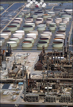 An oil refinery was submerged in water in Codin, Ala., yesterday. Oil prices scrambled toward $70 today as dealers feared a sharp squeeze on fuel supplies after Hurricane Katrina shut down vital US Gulf Coast refineries and offshore production platforms.