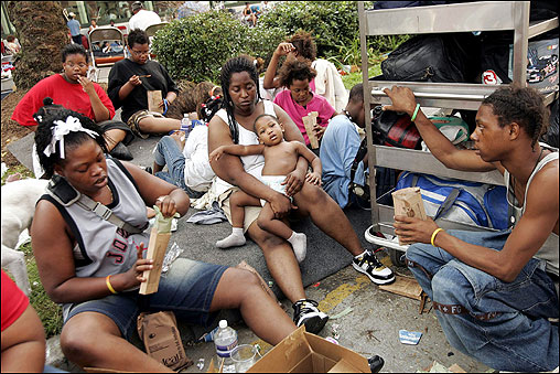 Katrina refugees sat in the streets outside the New Orleans Convention Center waiting to be evacuated.