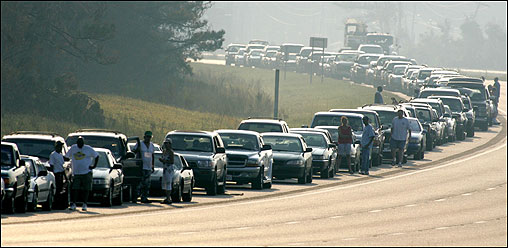 Motorists lined up for gasoline on Interstate 10 in Biloxi, Miss. Severe fuel shortages remain following the passing of Hurricane Katrina.
