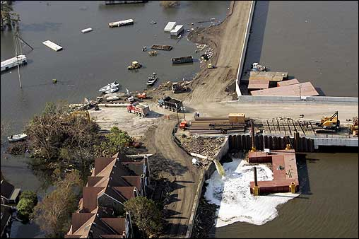 Crews worked to pump water and repair a levee breach that caused severe flooding in New Orleans.