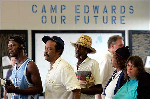 Evacuees from New Orleans waited in line for food stamps at Camp Edwards Monday.