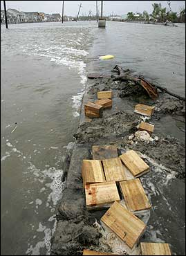 Flood waters swamped a residential area as they flowed over a road median from a second levee overflow in New Orleans.