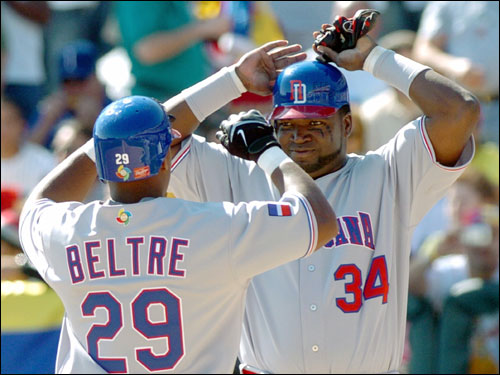 The Dominican Republic's Adrian Beltre (29) celebrated with teammate David Ortiz after Beltre's two-run home in the fifth inning against Venezuela.