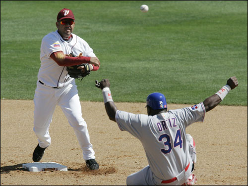 Ortiz (right) was caught in a double play by Venezuela's second baseman Edgardo Alfonzo in the third inning.