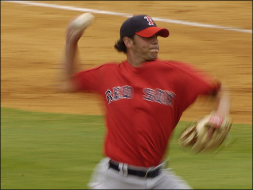 Red Sox pitcher David Pauley throws during Wednesday's spring training game against the Orioles.