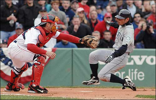 The game didn't start well for the Sox. Ichiro Suzuki, who had been 0-for-11 in the first three games of the series, lined a leadoff double in the first, then scored on Raul Ibanez's sacrifice fly. Here, he slid past Sox catcher Jason Varitek.