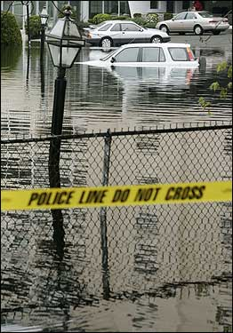 Police caution tape warned motorists to avoid this flooded parking lot in Melrose, Mass. The heaviest rains seen in New England in a decade have caused flooding across parts of the region.