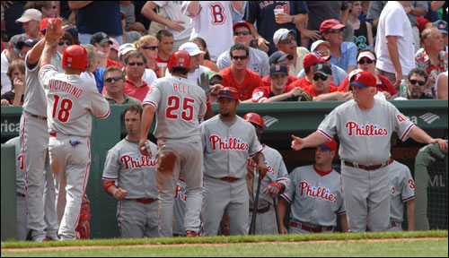 Shane Victorino and David Bell collected high-fives after scoring on a triple by Jimmy Rollins to start a rally against the Sox in the seventh inning.