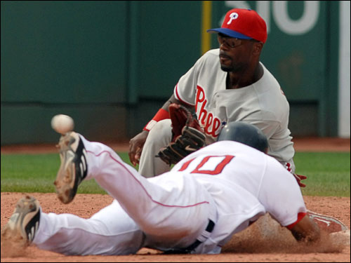 Coco Crisp dove into second on a steal attempt but the Phillies Jimmy Rollins made the tag in the seventh inning.
