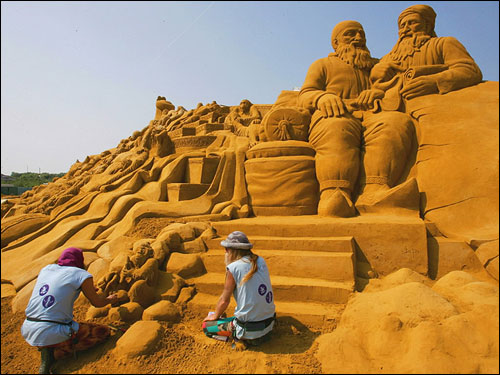 Sand sculptors carved out a creation during the Sand Sculptures Festival in Blankenberge, Belgium. A team of 40 carvers from around the world spent five weeks building a giant sculpture representing the world of Sheherazade and the giant book of The Thousand and One Nights.