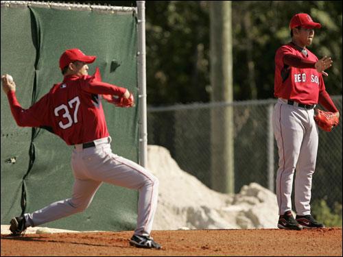 Red Sox pitchers Hideki Okajima (left) and Daisuke Matsuzaka threw in the bullpen Tuesday.