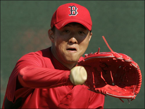 Red Sox pitcher Hideki Okajima fielded a ball during practice Tuesday.