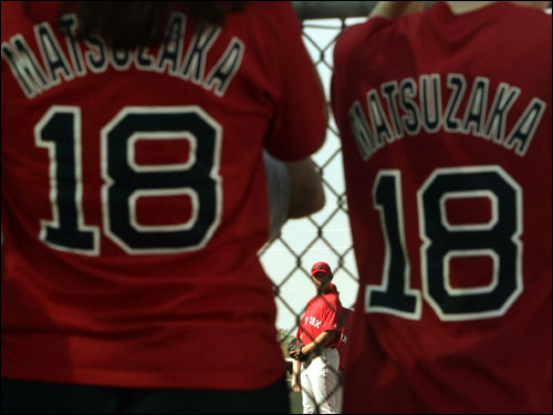 Matsuzaka (center) is seen between two fans wearing t-shirts with his name and number during practice Wednesday.
