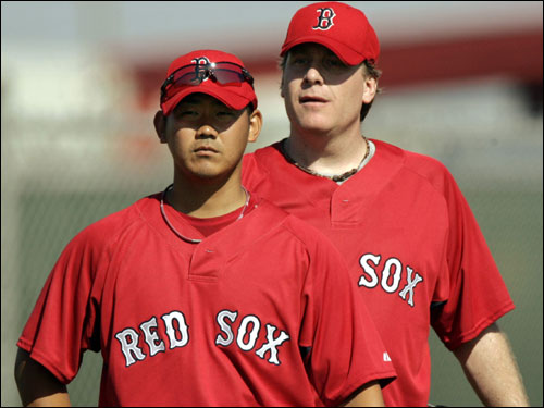 Matsuzaka (left) and Curt Schilling stood on the mound during practice in Fort Myers.