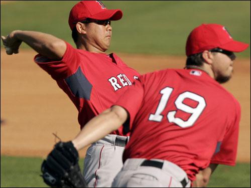 Daisuke Matsuzaka and Josh Beckett threw during practice Wednesday.