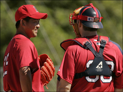 Red Sox pitcher Daisuke Matsuzaka (left) talked to catcher Jason Varitek during practice.