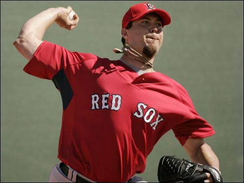 Red Sox pitcher Josh Beckett threw during practice Thursday.
