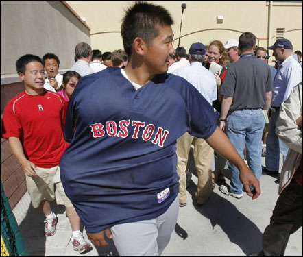Red Sox pitcher Daisuke Matsuzaka, with his arm wrapped in ice, walked away from reporters after interviews in Jupiter, Fla.