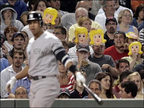 Fans wearing the blond-haired masks prepared for A-Rod's first at-bat as he waited in the on-deck circle in the fourth inning.