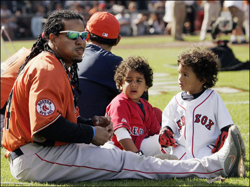 Manny Ramirez of the Red Sox watches the Home Run Derby in San Francisco with his son Manny Jr., center, and D'Angelo Ortiz on Monday.