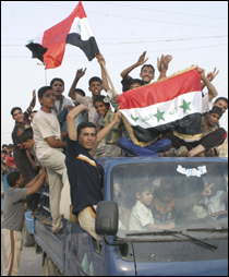 Residents ride a truck as they celebrate the victory of Iraq's soccer team over South Korea during the semi-final of the 2007 AFC Asian Cup soccer tournament, in Falluja, 30 miles west of Baghdad, July 25, 2007. (Reuters Photo)