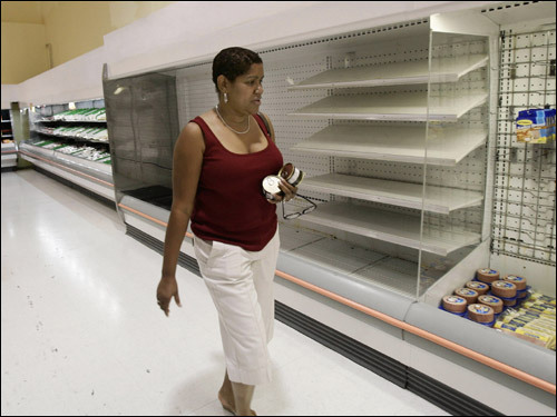 A shopper walked past empty shelves at a supermarket in Kingston, Jamaica, as residents prepared for the arrival of hurricane Dean.