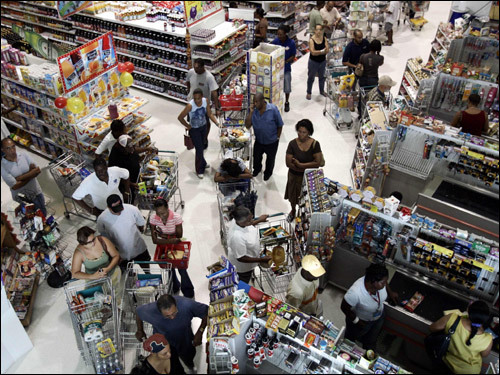 Residents bought supplies at a supermarket in Kingston, Jamaica, in preparation for the arrival of hurricane Dean.