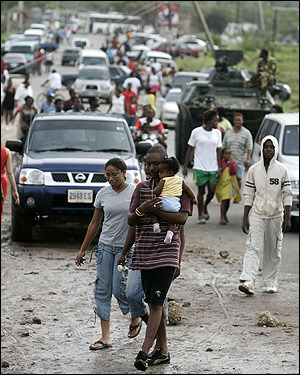 Residents of Kingston, Jamaica, wandered along a road that Hurricane Dean left covered in mud on Monday.