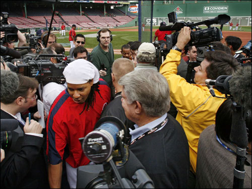 Manny Ramirez made his way through the media after talking with them during practice for the opening game of the World Series.