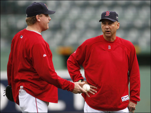 Curt Schilling (left) talked with manager Terry Francona during the team's workout Tuesday.