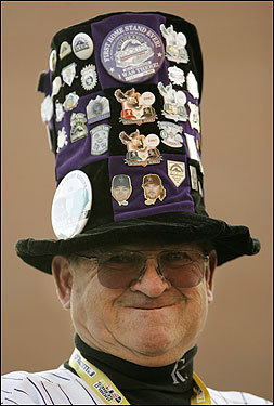 Colorado Rockies fan Bill Ragland showed off his souvenir-laden hat before Game 4.