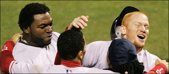 Bobby Kielty (right) celebrated with David Ortiz (left), Julio Lugo, and Manny Ramirez after hitting a solo home run against the Rockies in the eighth inning.