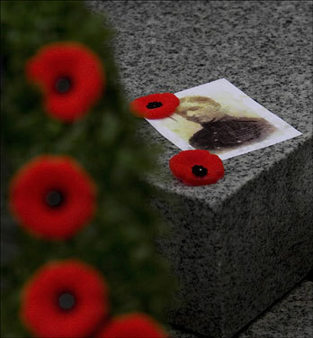 A photograph of Canadian World War I veteran John Milson was placed on a war memorial after Remembrance Day ceremonies on Sunday in North Vancouver, British Columbia. Several hundred people gathered at the small memorial to honor Canadian troops killed in both world wars as well as the wars in Korea and Afghanistan.