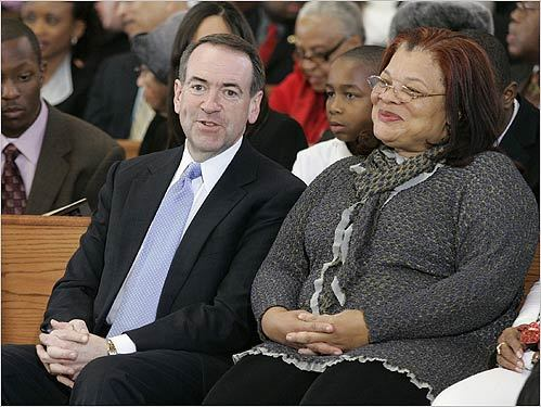 Mike Huckabee sat with Alveda King, the niece of slain civil rights leader Martin Luther King Jr., while attending the service at Ebenezer Baptist Church in Atlanta.