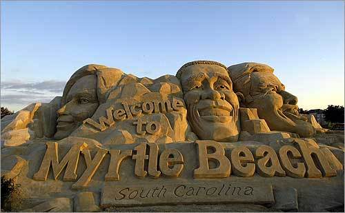 A sand sculpture of the top three Democratic presidential candidates was displayed outside the site of the presidential debate in Myrtle Beach, S.C.