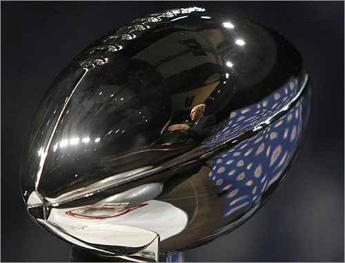 Giants head coach Tom Coughlin was reflected in the Vince Lombardi Trophy as he answered questions in advance of Sunday's Super Bowl.