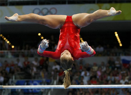 US gymnast Shawn Johnson flipped upside-down on the uneven bars.