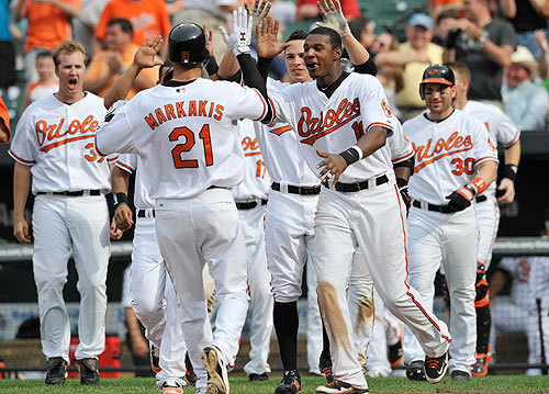 And so it ended. The Orioles greeted Nick Markakis as he scored on Ty Wigginton's single in the 10th inning today to complete a three-game sweep of the Red Sox.