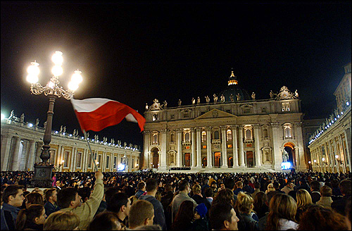 A Polish faithful waved his country's flag in St. Peter's Square.