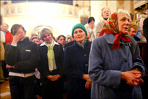 Worshippers prayed in the church of St. Mary in his home town of Wadowice, southern Poland, on Saturday after learning about the death of Pope John Paul II.