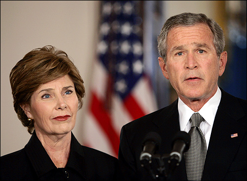 First lady Laura Bush listened as President Bush expressed his condolences in the Cross Hall of the White House.