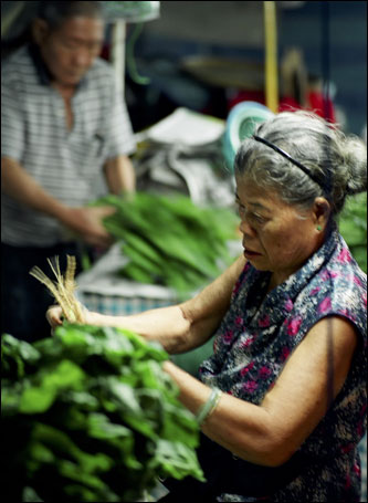 Vendors sell vegetables and other ingredients for Singapore's singular culinary stew.
