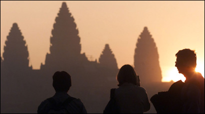 Foreign tourists photograph Cambodia's Angkor Wat temple complex in Siem Reap at sunrise. The vast 800-year-old site is the jewel in the crown of the war-ravaged Southeast Asian nation's nascent tourism industry.