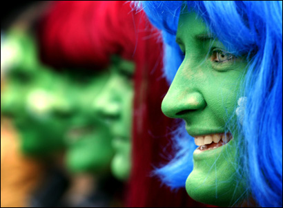 Women wearing festive costumes celebrate at the Cologne street carnival.