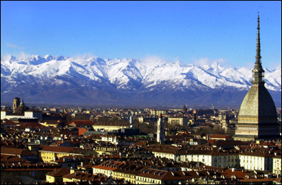 A view of Turin, Italy, with the main city landmark, the Mole Antonelliana, at right, and the Alps in background. One million people is expected to visit Turin during the 2006 Winter Games. Many other tourists are expected to visit the city, completely remodeled on the occasion, and enjoy its world-class food and wines, after the Feb. 10-26 Olympics.