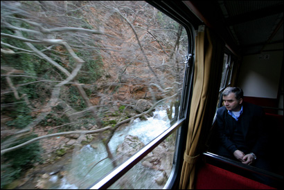 Four times a day. a diesel train hurtles down the narrow gauge railway through Vouraikos Gorge on Peloponnesian Peninsula.