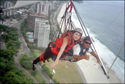 The author, left, and pilot Ricardo Hamond float above Rio De Janeiro's high-rises, Tijuca National Park, and Sao Conrado Beach on the Atlantic coast.