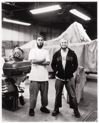 ''Yeah, man,'' says Abdul Atheem (left). ''Come by my shop. I'll help you with your project.'' I set off for Endemik Designs in Peabody to meet Atheem, a Dominican immigrant who also goes by Andy Santos, and Musa Abdur-Rahman, a Venezuelan immigrant also known as Juan Carlos Pina. ''What I love about Islam is the guidance,'' Atheem tells me. ''Now that I am a Muslim, I see the benefits of Islam. There are so many evils we see every single day. If people were to just follow what God had revealed, there would be peace, there wouldn't be war.'' The conversation turns to suicide bombers. ''Most people who do suicide bombings are ignorant, I don't care how Islamic they say they are,'' Abdur-Rahman says. ''Mohammed says if anybody kills himself or herself, God will punish them forever in that form which he has killed himself. If you blow yourself up, God will blow you up in the hellfire, rebuild you, and blow you up again for eternity.''